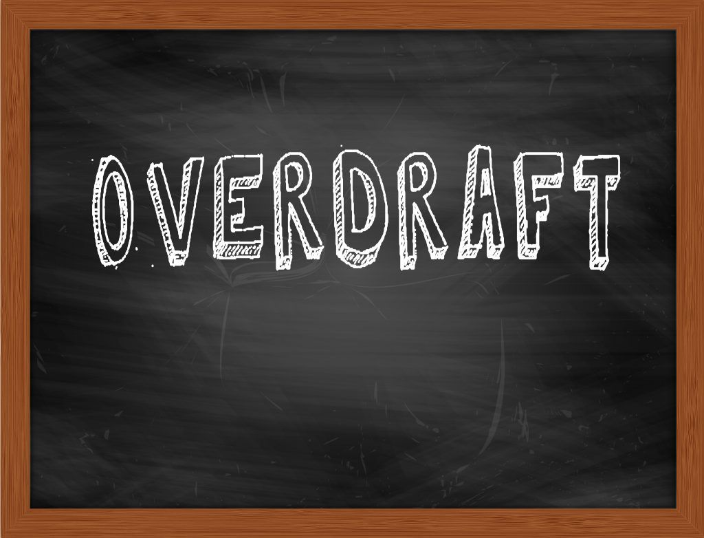 "chalkboard with the word ""overdraft"" written on it"