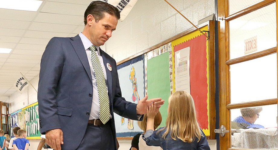 Dr. Pollio high-fiving a young girl