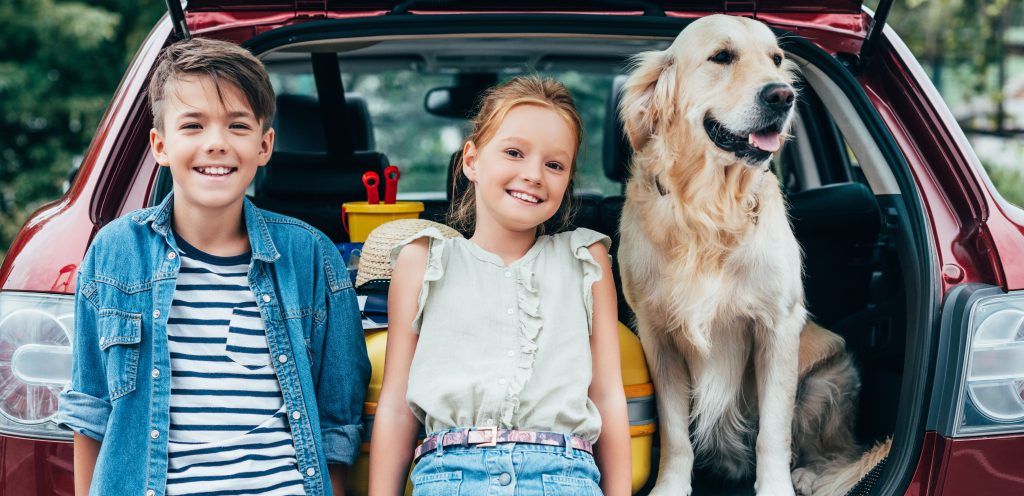 Children with dog in car